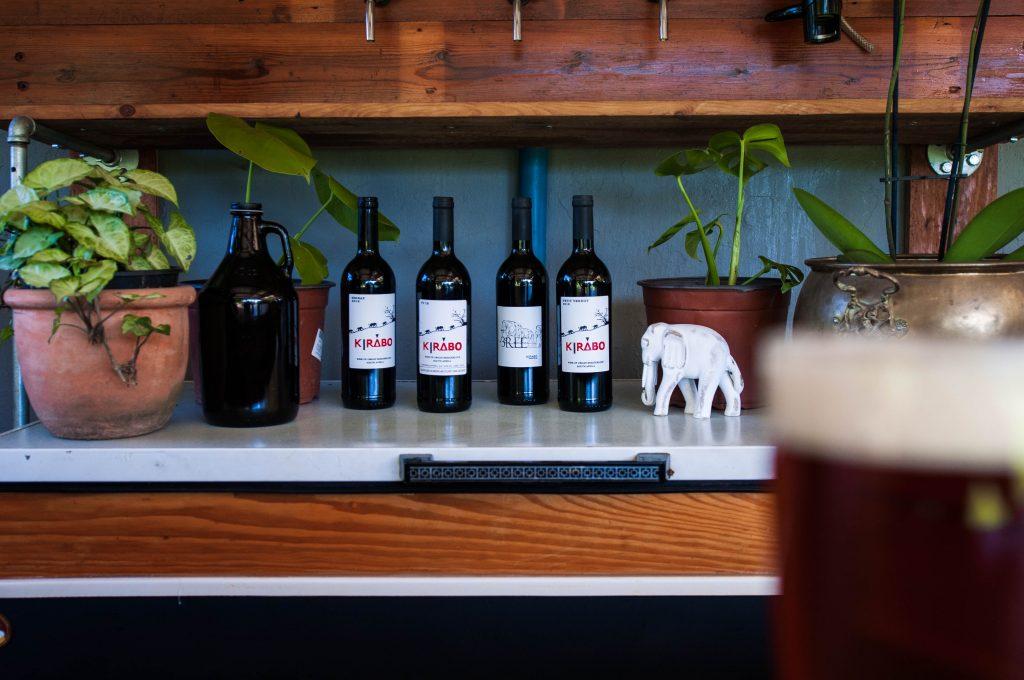 Kirabo wines on fridge.