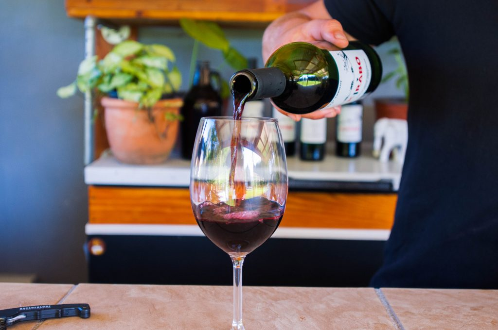 Kirabo wine being poured into a glass.