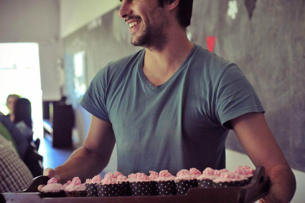 Boy holding cupcakes