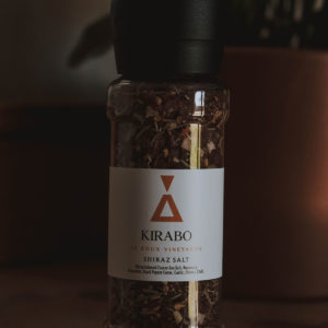 Kirabo's shiraz salt. White label with an orange copper triangle logo.