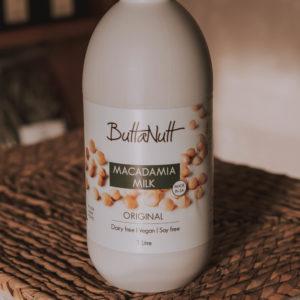 ButtaNutt's macadamia milk in a white plastic bottle.
